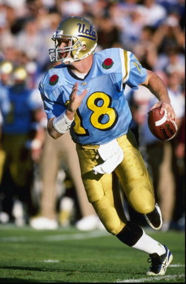 1 Jan 1999:  Cade McNown #18 of the UCLA Bruins carries the ball during the Rose Bowl against the Wisconsin Badgers  at the Rose Bowl in Pasadena, California. Wisconsin defeated UCLA 38-31. Mandatory Credit: Tom Hauck  /Allsport