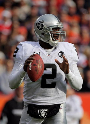 DENVER - NOVEMBER 23:  Quarterback JaMarcus Russell #2 of the Oakland Raiders delivers a pass against the Denver Broncos during week 12 NFL action at Invesco Field at Mile High on November 23, 2008 in Denver, Colorado. The Raiders defeated the Broncos 31-
