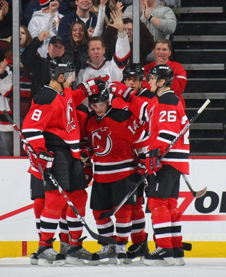 NEWARK, NJ - JANUARY 02: Brian Gionta #14 (C) of the New Jersey Devils is congratulated on his first period gaol against the Montreal Canadiens on January 2, 2009 at the Prudential Center in Newark, New Jersey. (Photo by Bruce Bennett/Getty Images)