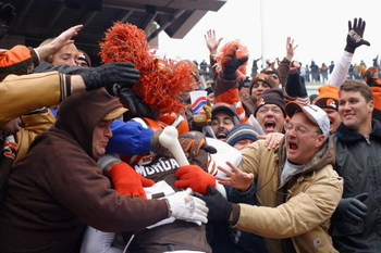 CLEVELAND - DECEMBER 15:  Wide receiver Quincy Morgan #81 of the Cleveland Browns celebrates his touchdown with the Dawg Pound during the game against the Indianapolis Colts at Cleveland Browns Stadium on December 15, 2002 in Cleveland, Ohio. The Colts wo