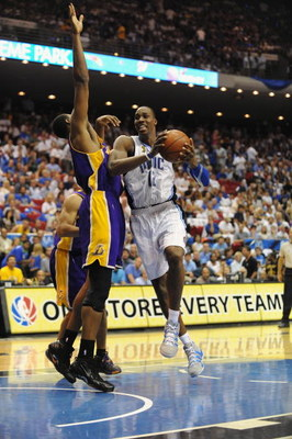 ORLANDO, FL - JUNE 14:  Dwight Howard #12 of the Orlando Magic moves through the lane against Andrew Bynum #17 of the Los Angeles Lakers in Game Five of the 2009 NBA Finals on June 14, 2009 at Amway Arena in Orlando, Florida. The Lakers won 99-86.  NOTE T