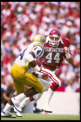 6 Sep 1986:  Linebacker Brian Bosworth (right) of the University of Oklahoma pursues a UCLA running back during the Sooners 38-3 win over UCLA at Memorial Stadium in Norman, Oklahoma. Mandatory Credit: Allsport  /Allsport