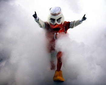 MIAMI - OCTOBER 14:  'Ibis' the University of Miami Hurricanes mascot runs through a smoke cloud prior to a game against the Florida International University Panthers at the Orange Bowl on October 14, 2006 in Miami, Florida.  (Photo by Marc Serota/Getty I