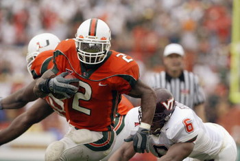 MIAMI - DECEMBER 7:  Running back Willis McGahee #2 of the University of Miami Hurricanes evades linebacker Vegas Robinson #6 of the Virginia Polytechnic Institute and State University Hokies during the game at the Orange Bowl on December 7, 2002 in Miami