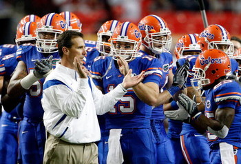 ATLANTA - DECEMBER 06:  Head coach Urban Meyer, quarterback Tim Tebow #15 and the Florida Gators prepare to face the Alabama Crimson Tide in the SEC Championship on December 6, 2008 at the Georgia Dome in Atlanta, Georgia.  (Photo by Kevin C. Cox/Getty Im