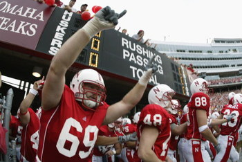 LINCOLN, NE - AUGUST 24:  Tackle Nick Povendo #69 of the Nebraska Cornhuskers explodes out of the tunnel before the NCAA football game against the Arizona State Sun Devils on August 24, 2002, at Memorial Stadium in Lincoln, Nebraska.  Nebraska defeated Ar