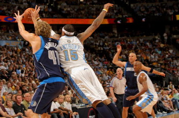DENVER - MAY 13:  Carmelo Anthony #15 of the Denver Nuggets knocks away a pass intended for Dirk Nowitzki #41 from Jason Kidd #2 of the Dallas Mavericks in Game Five of the Western Conference Semifinals during the 2009 NBA Playoffs at Pepsi Center on May