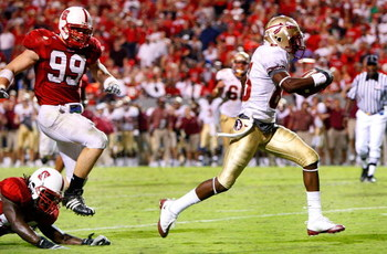 RALEIGH, NC - OCTOBER 16:  Receiver Bert Reed #83 of the Florida State Seminoles rushes for a touchdown in front of the North Carolina State Wolfpack during the game at Carter-Finley Stadium on September 16, 2008 in Raleigh, North Carolina.  (Photo by Kev