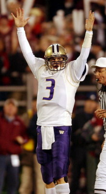 PULLMAN, WA - NOVEMBER 23:  Quarterback Cody Pickett #3 of the Washington Huskies signals touchdown  during their game against the Washington State Cougars on November 23, 2002 at Martin Stadium in Pullman Washington. The Huskies defeated the Cougars 29-2
