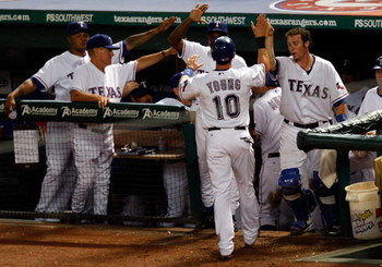 ARLINGTON, TX - JULY 27:  Third baseman Michael Young #10 of the Texas Rangers celebrates a run in the dugout on July 27, 2009 at Rangers Ballpark in Arlington, Texas.  (Photo by Ronald Martinez/Getty Images)