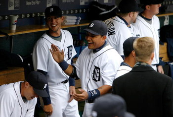 DETROIT - MARCH 31:  Miguel Cabrera #24 and Clete Thomas #36 of the Detroit Tigers share a laugh in the dugout against the Kansas City Royals during their game on Opening Day on March 31, 2008 at Comerica Park in Detroit, Michigan. Royals won 5-4 in 11 in