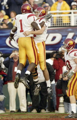 PASADENA, CA - JANUARY 1:  Wide receiver Mike Williams #1 of the USC Trojans celebrates with quarterback Matt Leinart #11 after Williams threw a touchdown to Leinart against the Michigan Wolverines during the 2004 Rose Bowl on January 1, 2004 at the Rose