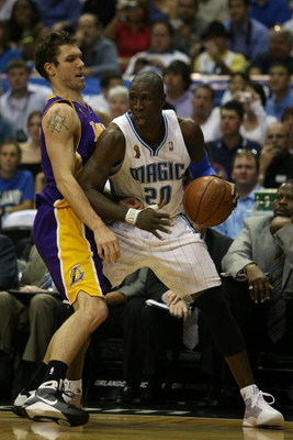 ORLANDO, FL - JUNE 14:  Mickael Pietrus #20 of the Orlando Magic goes up against Luke Walton #4 of the Los Angeles Lakers in Game Five of the 2009 NBA Finals on June 14, 2009 at Amway Arena in Orlando, Florida.  NOTE TO USER:  User expressly acknowledges