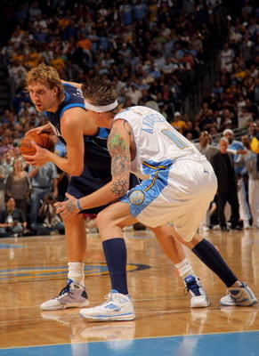 DENVER - MAY 13:  Dirk Nowitzki #41 of the Dallas Mavericks tries to drive against Chris Andersen #11 of the Denver Nuggets in Game Five of the Western Conference Semifinals during the 2009 NBA Playoffs at Pepsi Center on May 13, 2009 in Denver, Colorado.