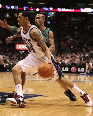 EAST RUTHERFORD, NJ - MARCH 04:  Devin Harris #34 of the New Jersey Nets dribbles the ball against Stephon Marbury #8 of Boston Celtics during their game on March 4th, 2009 at The Izod Center in East Rutherford, New Jersey.  NOTE TO USER: User expressly a