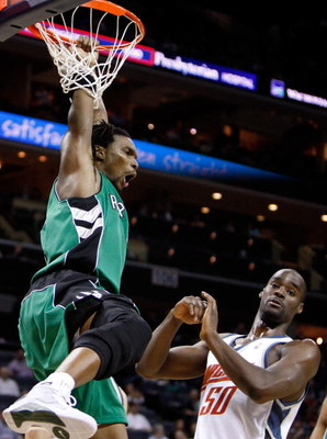 CHARLOTTE, NC - MARCH 16:  Chris Bosh #4 of the Toronto Raptors reacts after a dunk against Emeka Okafor #50 of the Charlotte Bobcats during their game at Time Warner Cable Arena on March 16, 2009 in Charlotte, North Carolina.  NOTE TO USER: User expressl