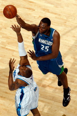 NEW ORLEANS - FEBRUARY 08:  Al Jefferson #25 of the Minnesota Timberwolves makes a shot over David West #30 of the New Orleans Hornets on February 8, 2009 in New Orleans, Louisiana.  The Hornets defeated the Timberwolves 101-97.  NOTE TO USER: User expres
