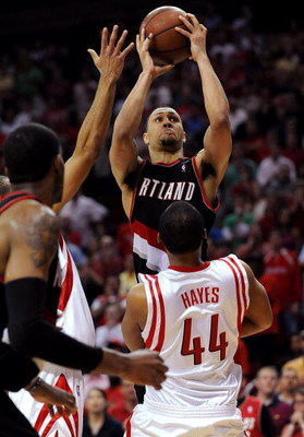 HOUSTON - APRIL 26:  Guard Brandon Roy #7 of the Portland Trail Blazers goes up for a shot where he is called for an offensive foul against Chuck Hayes #44 of the Houston Rockets in the last minute of play in Game Four of the Western Conference Quarterfin
