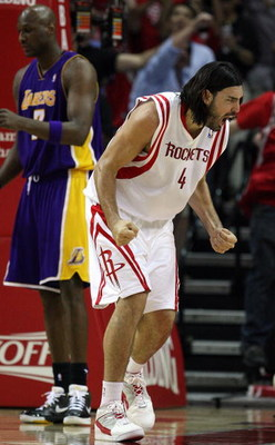 HOUSTON - MAY 14:  Forward Luis Scola #4 of the Houston Rockets reacts after making a shot against the Los Angeles Lakers in Game Six of the Western Conference Semifinals during the 2009 NBA Playoffs at Toyota Center on May 14, 2009 in Houston, Texas. NOT