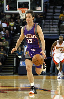 OAKLAND, CA - MARCH 15:  Steve Nash #13 of the Phoenix Suns dribbles the ball against the Golden State Warriors during an NBA game on March 15, 2009 at Oracle Arena in Oakland, California. NOTE TO USER: User expressly acknowledges and agrees that, by down