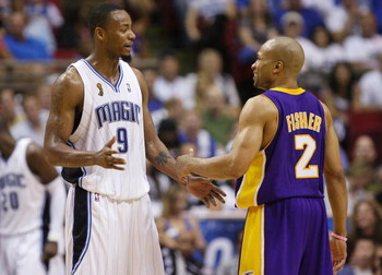 ORLANDO, FL - JUNE 11:  Rashard Lewis #9 of the Orlando Magic talks with Derek Fisher #2 of the Los Angeles Lakers in Game Four of the 2009 NBA Finals at Amway Arena on June 11, 2009 in Orlando, Florida.  The Lakers won 99-91 in overtime and lead the seri