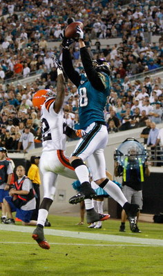 JACKSONVILLE, FL - OCTOBER 26:  Matt Jones #18 of the Jacksonville Jaguars attempts to make a reception against Brandon McDonald #22 of the Cleveland Browns in a game at Jacksonville Muncipal Stadium on October 26, 2008 in Jacksonville, Florida.  (Photo b