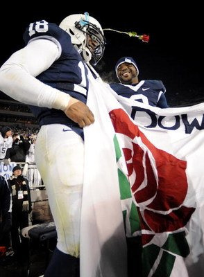 STATE COLLEGE, PA - NOVEMBER 22:  Navorro Bowman #18 and Derrick Williams #2 of the Penn State Nittany Lions raise a Rose Bowl banner after clinching the Big Ten title and advancing to the Rose Bowl after the game against the Michigan State Spartans on No