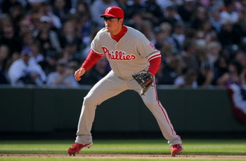 DENVER - APRIL 10:  Third baseman Greg Dobbs #19 of the Philadelphia Phillies plays defense against the Colorado Rockies during MLB action on Opening Day at Coors Field on April 10, 2009 in Denver, Colorado. The Rockies defeated the Phillies 10-3.  (Photo