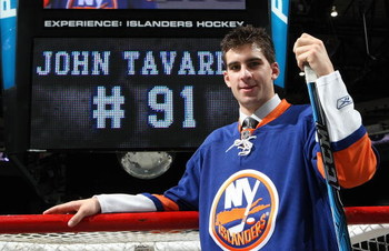 UNIONDALE, NY - JULY 08:  John Tavares of the New York Islanders is introduced to the media during a press conference on July 8, 2009 at the Nassau Coliseum in Uniondale, New York.  (Photo by Bruce Bennett/Getty Images)