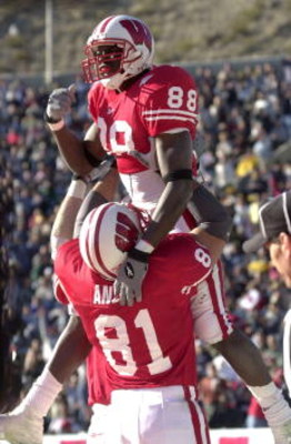 29 Dec 2000:  Chris Chambers #88 of  Wisconsin is hoisted in the air by teammate Mark Anelli #81 after Chambers scores a touchdown in the third quarter against UCLA during the Sun Bowl at Sun Bowl Stadium in El Paso, Texas.  Wisconsin beat UCLA 21-20.  DI
