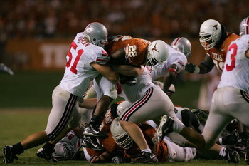 AUSTIN, TX - SEPTEMBER 09:   Running back Selvin Young #22 of the Texas Longhorns is tackled by Ross Homan #51 of the Ohio State Buckeyes on September 9, 2006 at Texas Memorial Stadium in Austin, Texas.  (Photo by Ronald Martinez/Getty Images)