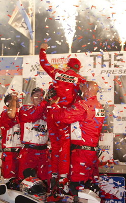 SPARTA, KY - AUGUST 01:  Ryan Briscoe driver of the #6 Team Penske Dallara Honda celebrates with his teamates after winning the IRL IndyCar Series Meijer Indy 300 on August 1, 2009 at the Kentucky Speedway in Sparta, Kentucky.  (Photo by Robert Laberge/Ge