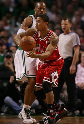 BOSTON - MAY 02:  Derrick Rose #1 of the Chicago Bulls passes the ball around Ray Allen #20 of the Boston Celtics in Game Seven of the Eastern Conference Quarterfinals during the 2009 NBA Playoffs at TD Banknorth Garden on May 2, 2009 in Boston, Massachus