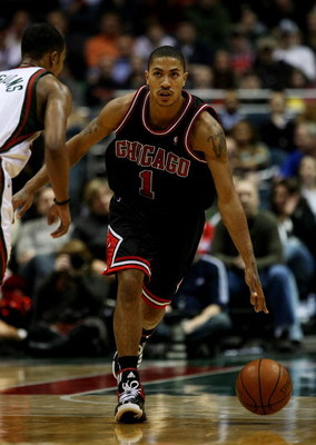 MILWAUKEE - FEBRUARY 18: Derrick Rose #1 of the Chicago Bulls moves upcourt against Ramon Sessions #7 of the Milwaukee Bucks on February 18, 2009 at the Bradley Center in Milwaukee, Wisconsin. The Bulls defeated the Bucks 113-104. NOTE TO USER: User expre