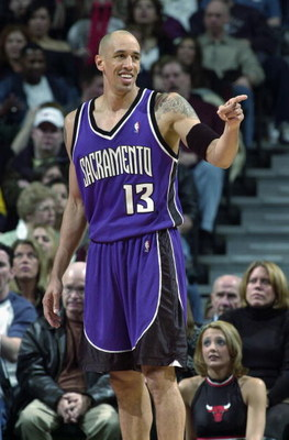 CHICAGO - MARCH 29:  Doug Christie #13 of the Sacramento Kings smiles during the game against the Chicago Bulls at the United Center on March 29, 2003 in Chicago, Illinois.  The Kings won 107-92.  NOTE TO USER: User expressly acknowledges and agrees that,