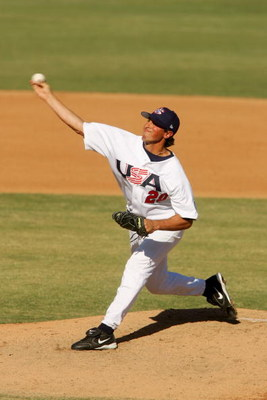 PHOENIX - NOVEMBER 17:  Pitcher Brian Sanches #20 of the USA delivers a pitch against Nicaragua during the CONCEBE Olympic Qualifier on November 17, 2005 at Maryvale Stadium in Phoenix, Arizona.  The USA won 7-4.  (Photo by Harry How/Getty Images)