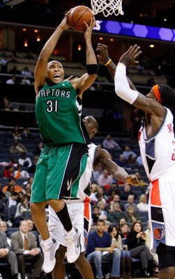 CHARLOTTE, NC - MARCH 16:  Shawn Marion #31 of the Toronto Raptors goes to the basket against teammates Emeka Okafor #50 and Gerald Wallace #3 of the Charlotte Bobcats at Time Warner Cable Arena on March 16, 2009 in Charlotte, North Carolina.  NOTE TO USE