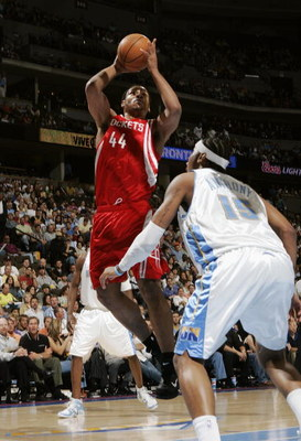 DENVER - APRIL 17:  Chuck Hayes #44 of Houston Rockets shoots over Carmelo Anthony #13 of the Denver Nuggets on April 17, 2006 at the Pepsi Center in Denver, Colorado.  The Rockets won 86-83.  NOTE TO USER: USER expressly acknowledges and agrees that, by