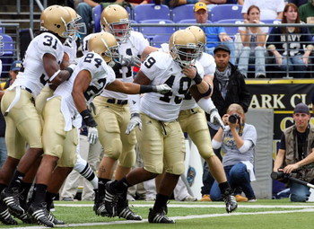 BALTIMORE - NOVEMBER 15:  Toryan Smith #49 of the Notre Dame Fighting Irish celebrates his first quarter touchdown with his teammates after he returned a blocked punt against the Navy Midshipmen on November 15, 2008 at M&T Bank Stadium in Baltimore, Maryl