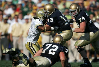 SOUTH BEND, IN - SEPTEMBER 01: Evan Sharpley #13 of the Notre Dame Fighting Irish is sacked by Morgan Burnett #1 of the Georgia Tech Yellow Jackets as teammates Paul Duncan #72 and Sam Young #74 watch on September 1, 2007 at Notre Dame Stadium in South Be