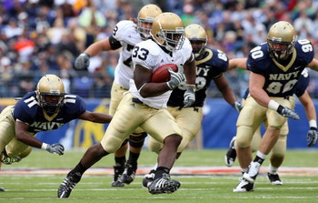 BALTIMORE - NOVEMBER 15:  Robert Hughes #33 of the Notre Dame Fighting Irish runs the ball against the Navy Midshipmen on November 15, 2008 at M&T Bank Stadium in Baltimore, Maryland. Notre Dame defeated Navy 27-21.  (Photo by Jim McIsaac/Getty Images)