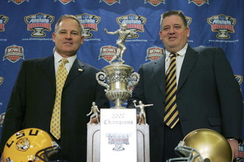 NEW ORLEANS - JANUARY 2:  Head coach Les Miles of Lousiana State University (L) and head coach Charlie Weis of the University of Notre Dame (R) pose with the Allstate Sugar Bowl trophy during a news conference January 2, 2007 in New Orleans, Louisiana.  (