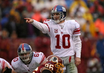 LANDOVER, MD - NOVEMBER 30:  Eli Manning #10 of the New York Giants runs points to his team against the Washington Redskins during their game at FedEx Field on November 30, 2008 in Landover, Maryland.  (Photo by Streeter Lecka/Getty Images)