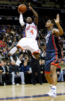 CHARLOTTE, NC - MARCH 28:  Boris Diaw #32 of the Charlotte Bobcats watches as Nate Robinson #4 of the New York Knicks goes to the basket during their game at Time Warner Cable Arena on March 28, 2009 in Charlotte, North Carolina.  NOTE TO USER: User expre
