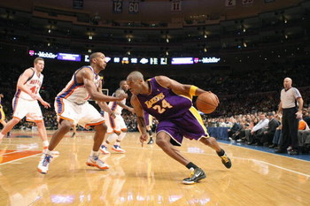 NEW YORK - FEBRUARY 2: Kobe Bryant #24 of the Los Angeles Lakers drives the ball against the New York Knicks on February 2, 2009 at Madison Square Garden in New York City. NOTE TO USER: User expressly acknowledges and agrees that, by downloading and or us