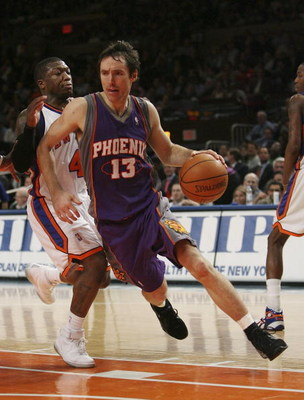 NEW YORK - JANUARY 24:  Steve Nash #13 of the Phoenix Suns drives against Nate Robinson #4 of the New York Knicks January 24, 2007 at Madison Square Garden in New York City. NOTE TO USER: User expressly acknowledges and agrees that, by downloading and or