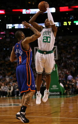 BOSTON - NOVEMBER 18:  Ray Allen #20 of the Boston Celtics takes a shot as Wilson Chandler #21 of the New York Knicks defends on November 18,  2008 at TD Banknorth Garden in Boston, Massachusetts. NOTE TO USER: User expressly acknowledges and agrees that,