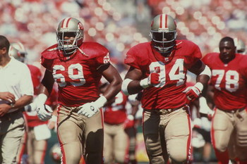 17 Sep 1995:  Offensive lineman Ron Milstead #69 of the San Francisco 49ers jogs onto the field with defensive lineman #94 Dana Stubblefield and the rest of the team during pre-game warm ups before the 49ers 28-3 victory over the New England Patriots at3C
