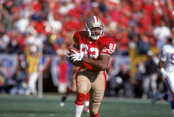 SAN FRANCISCO - JANUARY 15:  Wide receiver John Taylor #82 of the San Francisco 49ers runs with the ball during the 1993 NFC Championship game against the New York Giants at Candlestick Park on January 15, 1994 in San Francisco, California.  The 49ers won
