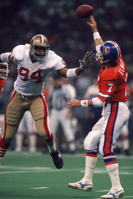 NEW ORLEANS - JANUARY 28:  Defensive end Charles Haley #94 of the San Francisco 49ers pressures Denver Broncos quarterback John Elway #7 in Super Bowl XXIV at Louisiana Superdome on January 28, 1990 in New Orleans, Louisiana.  The 49ers won 55-10.  (Photo